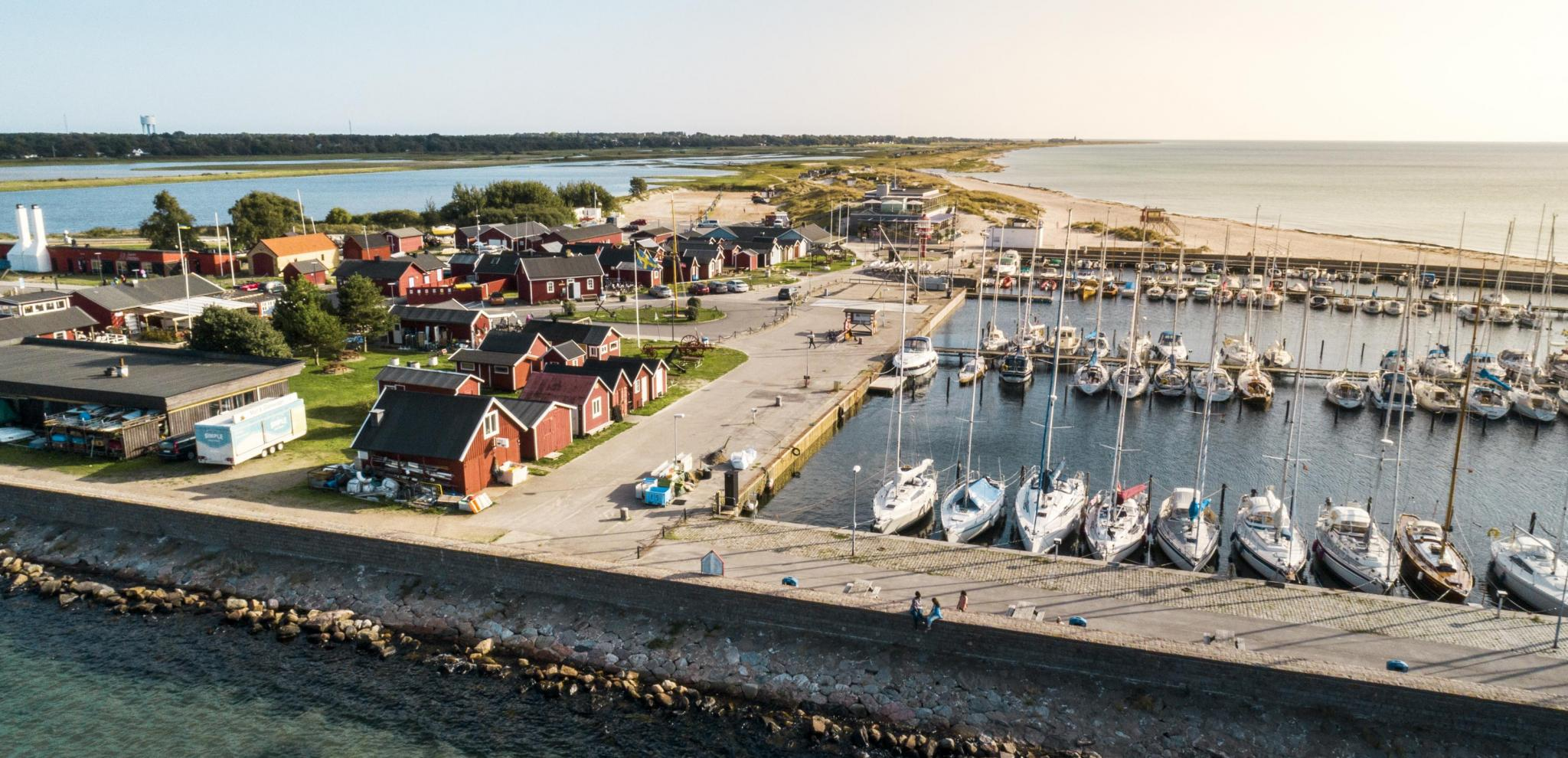 View from above on Skanör harbor with boats and small houses.