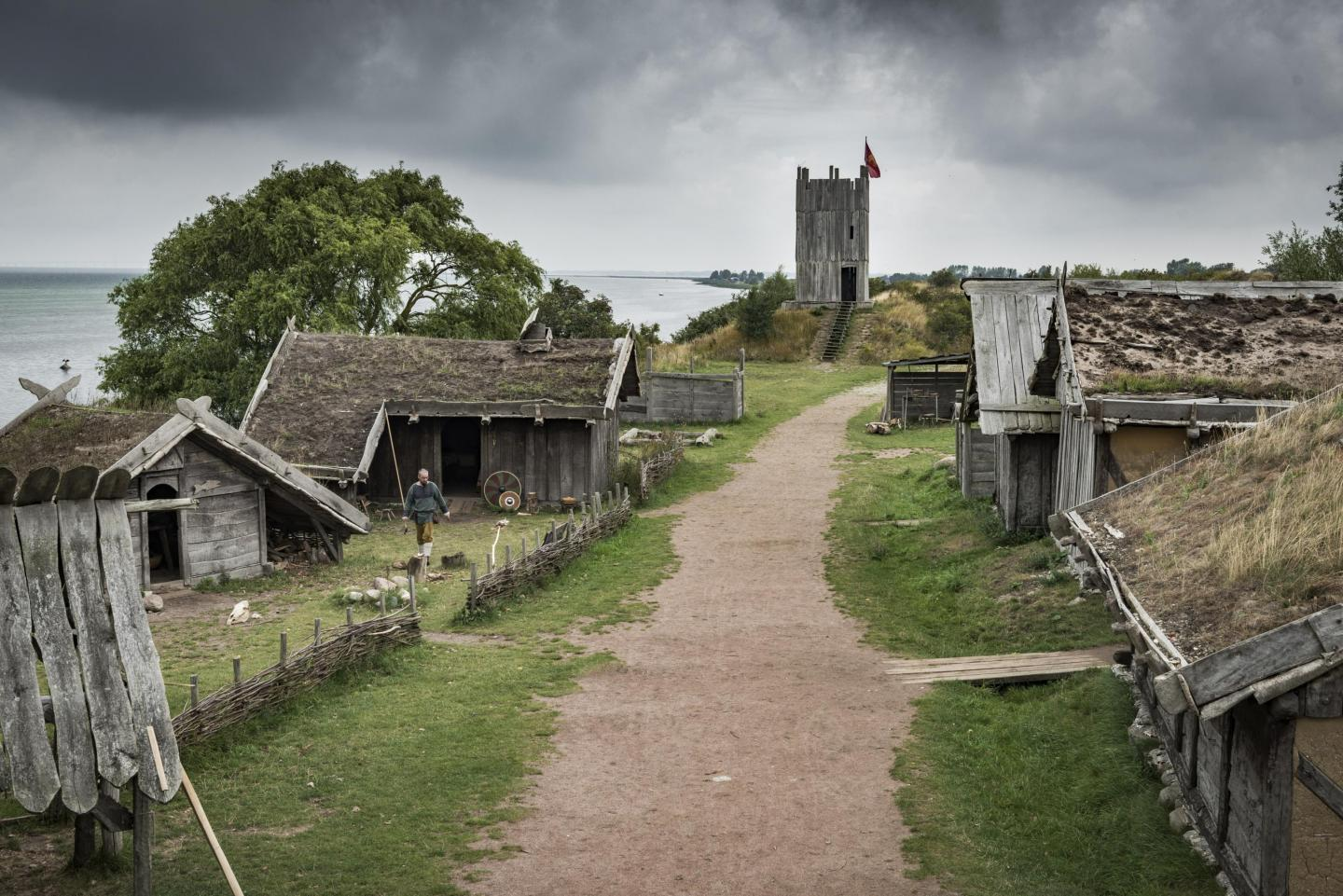 Viking village with gravel road and surrounding wood houses