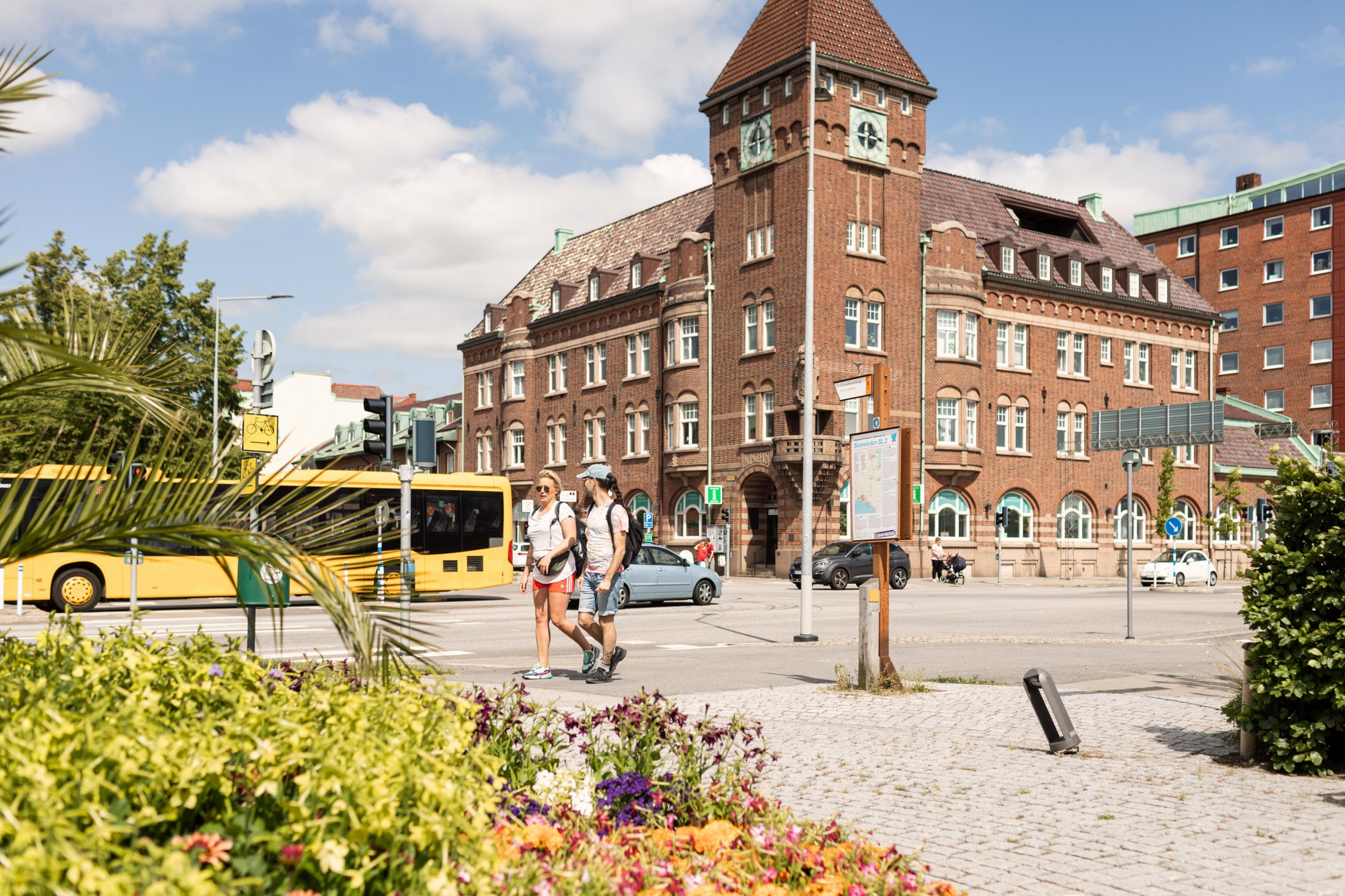 A sunny day in the center of Trelleborg. Buses, cars and people are passing by.